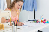 Female fashion designer working on her designs — Stock Photo