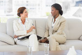 Happy businesswomen planning in diary together on the sofa — Stock Photo