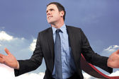 Composite image of businessman posing with arms out — Stock Photo