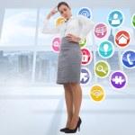 Composite image of focused businesswoman — Stock Photo