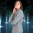 Stock Photo: Composite image of concentrating businesswoman