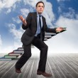 Composite image of businessmposing with arms outstretched — Stockfoto #39232825