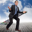 Composite image of businessmposing with arms outstretched — Stock Photo #39232825