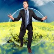 Composite image of businessmposing with arms outstretched — Stockfoto #39233077
