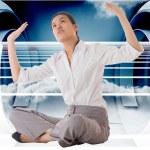 Composite image of businesswoman sitting cross legged pushing up — Stock Photo #39233305