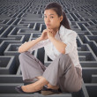 Stock Photo: Composite image of businesswomsitting cross legged with hands
