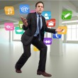 Composite image of businessmposing with arms outstretched — Stock Photo #39234167