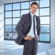 Composite image of smiling businessman with hands on hips — Stock Photo #39234267
