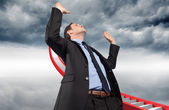 Composite image of businessman posing with arms raised — Stock Photo
