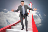 Composite image of businessman standing with arms out — Stock Photo