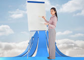 Composite image of businesswoman painting on an easel — Stock Photo