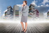 Composite image of worried businesswoman — Stockfoto