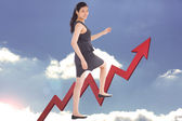 Composite image of businesswoman stepping up — Stock Photo