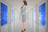 Composite image of happy businesswoman — Stock Photo