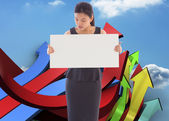 Composite image of businesswoman holding a placard — 图库照片