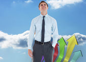 Smiling businessman standing with hand in pocket — Stock Photo