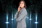 Composite image of concentrating businesswoman — Stock Photo