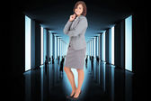 Composite image of smiling thoughtful businesswoman — Stock Photo