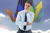 Composite image of upset thinking businessman — Stock Photo