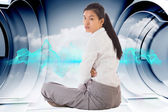 Composite image of businesswoman sitting cross legged frowning — Stock Photo