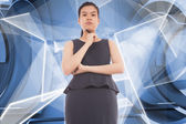 Composite image of thinking asian businesswoman — Stock Photo