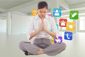 Composite image of businesswoman sitting in lotus pose — Stock Photo