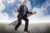 Composite image of businessman posing with arms outstretched — Foto Stock