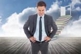 Cheerful businessman standing with hands on hips — Stock Photo