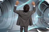 Composite image of businessman standing with arms pressing up — Stock Photo