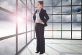 Composite image of serious businesswoman — Stock Photo