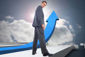 Composite image of serious businessman — Stock Photo