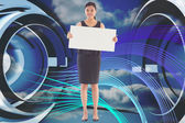 Composite image of businesswoman holding a placard — Stockfoto