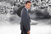 Composite image of cheerful handsome businessman standing — Stock Photo