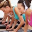 Aerobics class doing press ups together led by instructor — Stok video