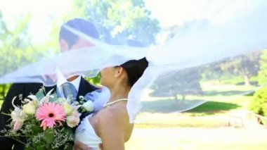 Happy newlyweds standing in the park — Stock Video