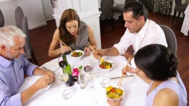 Friends enjoying an asian meal together — Vídeo de stock