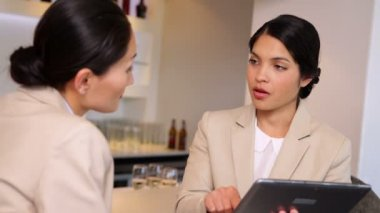Businesswomen looking at tablet — Stock Video