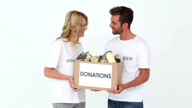 Two volunteers holding a donations box — Stock Video