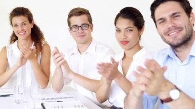 Business people applauding the camera — Vídeo Stock