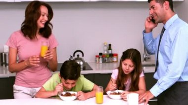 Family having breakfast together in kitchen — Stock Video