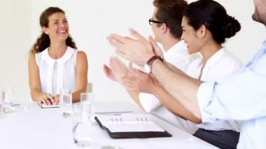 Business people applauding their boss during meeting — Stockvideo