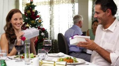 Couple having a christmas meal together and exchanging gifts — Stock Video