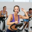 Spinning class in fitness studio led by energetic instructor — Stok video #42650317