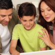 Parents using laptop with their son — Stock Video #42651499