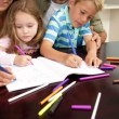 Children drawing at the table with their parents — Stock Video #42652271