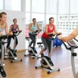 Spinning class in fitness studio led by energetic instructor — Stock Video #42653207