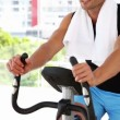 Fit man working out on exercise bike — Stock Video #42654479