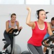 Spinning class in fitness studio led by energetic instructor — Vídeo Stock #42658309