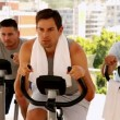 Three men working out on exercise bikes — Stock Video #42659071