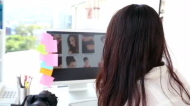 Photo editor working at her desk — Stok video